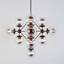 above the bronze modo diamond chandelier from future perfect is available in black and with either smoked or clear glass globes s start at 5 800