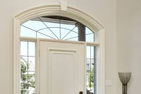 decorative windows above main entrance door