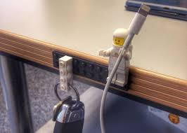 who knew that lego designed their figures hands perfectly to hold apple lightning and other types of cables stick a lego brick on your desk