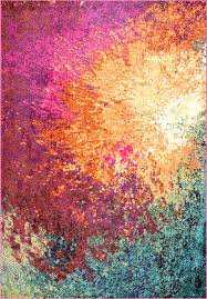 add a pop of statement color to your home with one of these gorgeous bold chroma abstract seascape rug