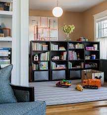 View in gallery Stylish storage shelf idea for the playroom