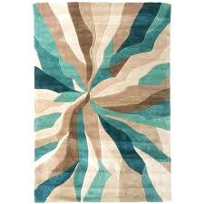 teal colored area rugs nebula rug in beige teal blue and brown a liked on featuring