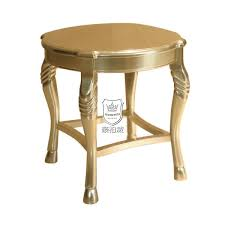 hotel lobby round gold side table carving on legs