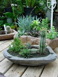 simply combine plants with earth sand and gravel together to create an overall concept of natural landscape beauty