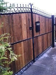 iron gates with wood panels joking hazard wrought and driveways t34