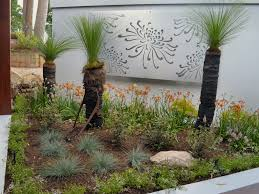 native garden by brookes blooms with grass trees kangaroo paws lomandras landscape designing australian plants gardening
