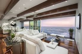 ocean view contemporary living room with sliding glass doors wood flooring and beam ceiling