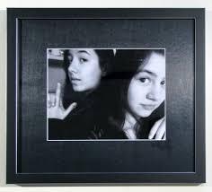 dark black white selfie in black mat and black with silver frame