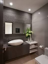 Example of a mid-sized trendy gray tile ceramic floor and beige floor powder  room