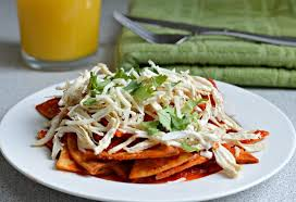 chilaquiles made with a base of freshly cooked homemade tortilla chips that are then submerged