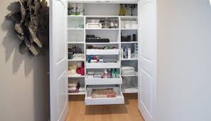 custom hallway closet with pull out shelves