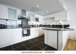 Concept Modern White Kitchen Dark Floor Tile Floors Home Pinterest Flooring To Design
