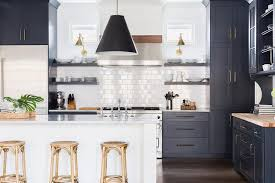 alyssa rosenheck dark blue shaker kitchen cabinets with white center island and madeleine backless stools