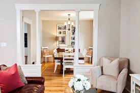 change of plans rolling doors are out and pony walls with columns are in beautiful living room pillar