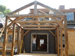 this is another new frame cut from antique timber it is 12 x14 and was closed in as a screened porch we cut a simple king post truss from hewn chestnut