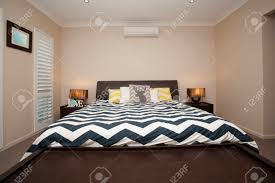 air conditioning for bedroom. master bedroom with king size bed and air conditioning stock photo - 37743196 for