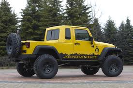 the do it yourself mopar kit allows owners to convert a 4 door jeep wrangler unlimited into a two door pickup truck with seating for two and a pickup style