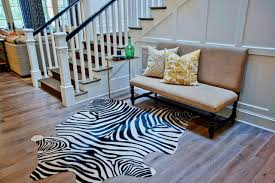 full size of black and white zebra faux hide rug with chair beside stairs on natural
