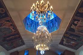 a large glass chandelier hanging under a blue dome