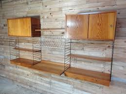 large wall shelving unit with desk by nisse strinning for string 1950s 1