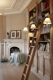 bookshelves next to fireplace with modern table tops contemporary beige and