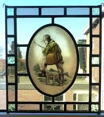 stained glass sun beautiful stained glass sun catcher with an image of a hunter with his