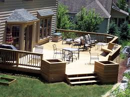Here's a large deck designed with wood box pillars at steps.