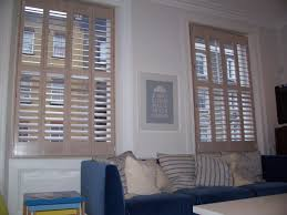 main wooden window shutters in limed white full height with 89mm louvers