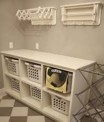 Wall shelves and cabinet with door from ikea as laundry room storage ideas