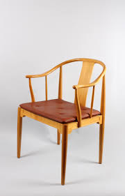 China chair - The first chair that Wegner designed in 1944. It was inspired  by