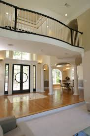 View of Foyer and Dining room of LAURIE house plan featured on Fine Living  TV mediterranean