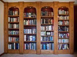 Bookshelf Lighting Floor To Ceiling Bookshelf With Arched Glass Doors And Lighting Of