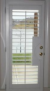 french doors with shutters. Hunter Douglas Heritance Wood Shutter With French Door Cutout Doors Shutters F
