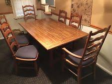 pennsylvania house oak dining table with 8 ladder back chairs 2 leaves