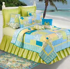 hawaiian coastal beach bedrooms style with persian square decorative rugs and green aqua tropical bedding