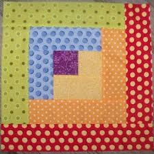 Cozy Up with Free Log Cabin Quilt Patterns! - FaveCrafts & Rainbow Log Cabin Quilt Block Adamdwight.com