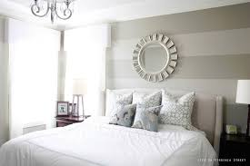 Striped Master Bedroom Wall With White Bedding