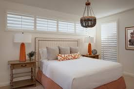 wood bead chandelier bedroom traditional with nailhead trim orange accents