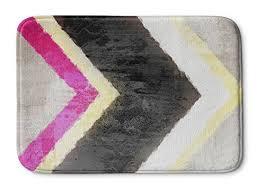 kavka designs arrow memory foam bath mat yellow white black pink
