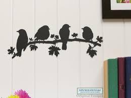 four birds on branch metal wall art