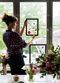 making dried flowers in glass frame hobby handmade stock photo images