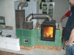 Installation Of The Absorber Plates In The Tiled Stove By A