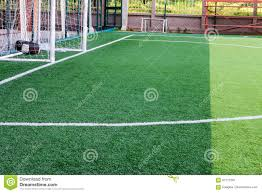 grass soccer field with goal. Soccer Field Grass Goal At The Stadium With White Lines On L