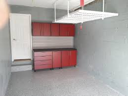 red cabinet with drawer in the garage after remodel painted with gray color exposed concrete wall and floor with plus hanging ceiling storage ideas