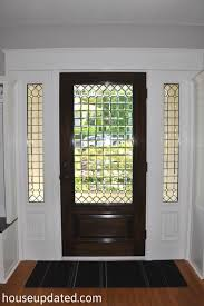 glass front door stained white trim