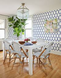 blue and white dining room parsons table beaded chandelier wallpaper bistro chairs room ideas r45 ideas