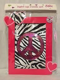new justice girls light up room art peace symbol pink with zebra print backing