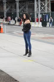 female model posing for photographer on