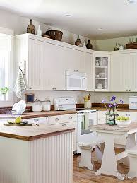 10 ideas for decorating above kitchen cabinets not sure what to do with that awkward