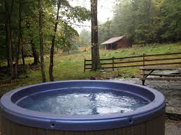 Hot tub with a view of the land. At night look up at the sky